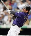 Helton continues to rake