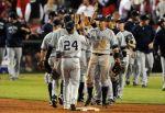 The Yankees celebrate after a Game 4 win